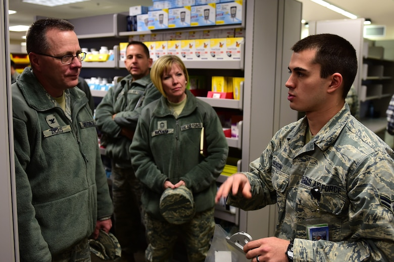 Airman 1st Class Lukas M. Henson, 460th Medical Group pharmacy technician on Buckley Air Force Base, Colo., explains his job to Col. John R. Andrus, Air Force Space Command Surgeon General Nov. 30th, 2016, at the pharmacy on Buckley Air Force Base, Colo. Henson helped brief the Surgeon General on the duties and responsibilities of pharmacy technicians in the 460th MDG. (U.S. Air Force photo by Airman Jacob Deatherage/Released)