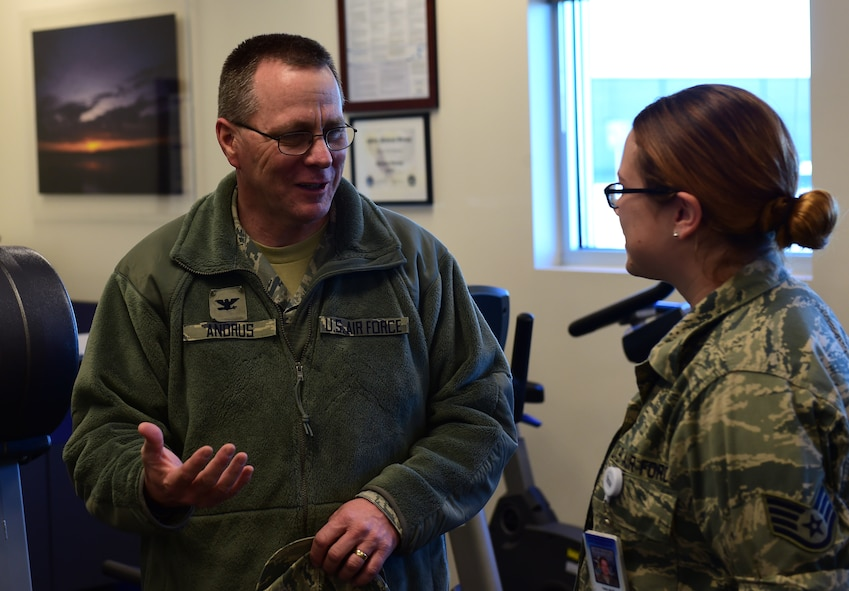 Col. John R. Andrus, Air Force Space Command Surgeon General, discusses current treatment methods with Staff Sgt. Tara L. Moss, 460th Medical Group physical therapy technician Nov. 30, 2016, at the Health and Wellness Center on Buckley Air Force Base, Colo. Moss received a coin from the Surgeon General for her outstanding work with patients undergoing rehabilitation. (U.S. Air Force photo by Airman Jacob Deatherage/Released)