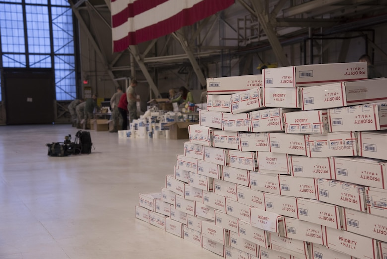 Team Fairchild volunteers pack more than 400 care packages for deployed military members as part of a KREM 2 News Station initiative, Treats 2 Troops, Dec. 1, 2016 at Fairchild Air Force Base. The care packages are filled with small treats and items such as beef jerky, sanitizer wipes, lens cleaning cloths, shampoo and hand-held games. (U.S. Air Force photo/Senior Airman Nick J. Daniello)