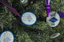 Paper ornaments adorn Holloman's first sergeant Diamond Tree inside the Base Exchange at Holloman Air Force Base, N.M. on Nov. 29, 2016. The Diamond Tree program offers assistance to low income and junior enlisted families who are not able to afford Christmas gifts for their children. (U.S. Air Force photo by Airman 1st Class Alexis P. Docherty)