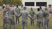 Students perfecting the art of teamwork during one of the team-building exercises in the  Air Force Reserve Command Senior NCO Leadership Development Course, held at Joint Base San Antonio, Texas, on Nov. 4-5, .