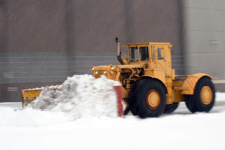 Personnel and equipment assigned to the 75th Civil Engineer Squadron remove heavy, wet snow from the Hill Air Force Base flightline and industrial-area roadways Nov. 28. According to the 75th Operations Support Squadron Weather Flight, the storm bought 7 inches of snow to Hill, the first significant snow event of the winter season. (U.S. Air Force photos by Todd Cromar)