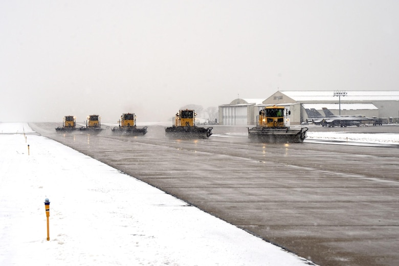 High-capacity sweeper vehicles clear the Hill Air Force Base taxiway of snow, Dec. 1, 2016. These trucks and other snow removal vehicles are kept in top shape to ensure the airfield is operational all winter long, during any weather conditions. (U.S. Air Force photos by Todd Cromar)