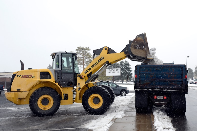Personnel and equipment assigned to the 75th Civil Engineer Squadron remove snow from a Hill Air Force Base parking lot, Dec. 1. (U.S. Air Force photos by Todd Cromar)