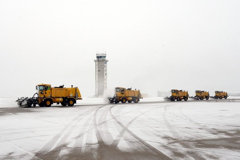 High-capacity sweeper vehicles clear the Hill Air Force Base taxiway of snow, Dec. 1, 2016. During the winter season from Nov. 1 through April 1, the snow removal team has 70 employees who work 24/7, operating 65 pieces of snow-removal equipment to remove 65-70 inches of snow each year. (U.S. Air Force photos by Todd Cromar)
