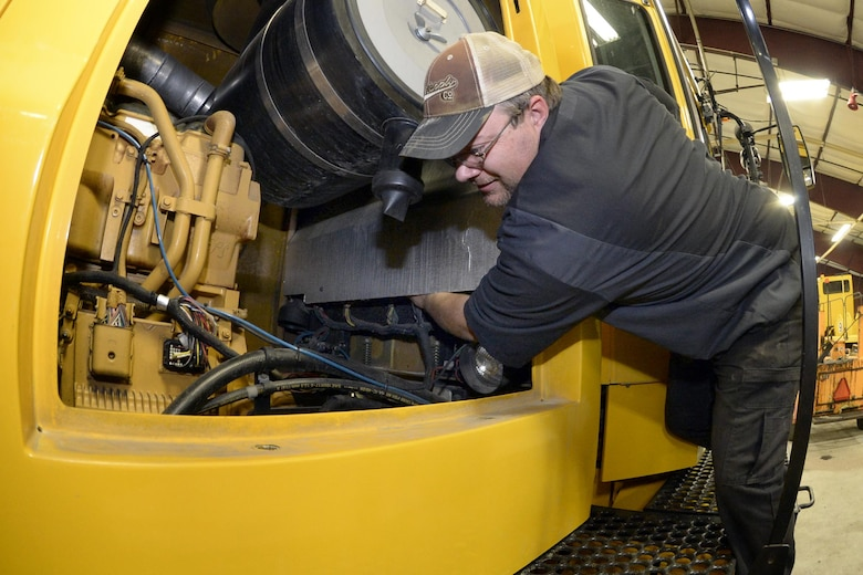 Tom Giles, 75th Logistics Readiness Squadron, performs maintenance on a blower truck in the snow barn at Hill Air Force Base, Dec. 1. These trucks and other snow removal vehicles are kept in top shape to fulfill their mission of keeping the airfield here operational during any weather conditions. (U.S. Air Force photos by Todd Cromar)