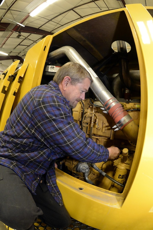 Delane Vaughn, 75th Logistics Readiness Squadron, performs maintenance on a blower truck in the snow barn at Hill Air Force Base, Dec. 1. The 75th LRS snow removal team prides itself on being the best in the Air Force (U.S. Air Force photos by Todd Cromar)