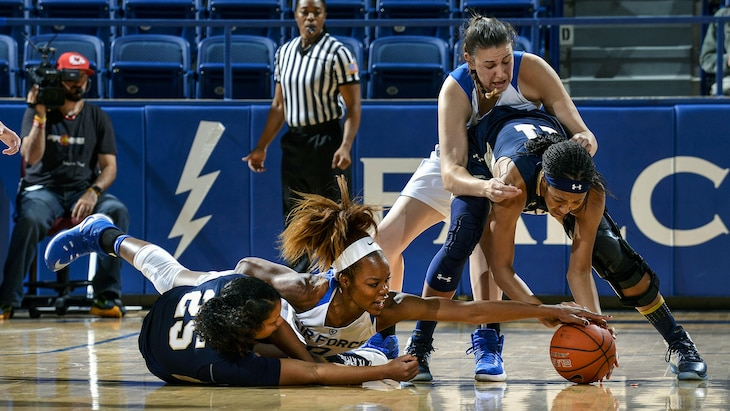 Dee Bennett, a junior, battles for the ball at the U.S. Air Force Academy in Colorado Springs, Colo., Nov. 29, 2016. The Midshipmen defeated the Falcons, 64-46. Air Force photo by Jason Gutierrez