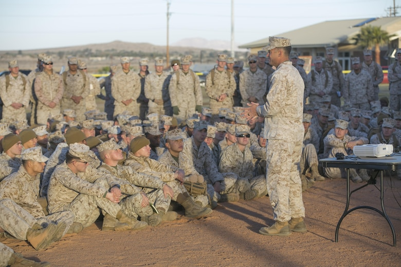 Lt. Col. Christopher Meyers, commanding officer, 1st Tank Battalion, speaks with his Marines at the start of the battalion's operational pause at Del Valle Field aboard the Marine Corps Air Ground Combat Center, Twentynine Palms, Calif., Nov. 29, 2016. During the operational pause, the Marines talked in guided discussions about various issues that are affecting units throughout the Marine Corps. (Official Marine Corps photo by Cpl. Thomas Mudd/Released)