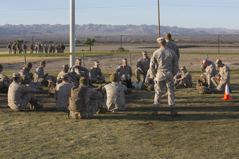 Marines of 1st Tank Battalion conduct a guided discussion on suicide prevention during the battalion's operational pause at Del Valle Field aboard the Marine Corps Air Ground Combat Center Twentynine Palms, Calif., Nov. 29, 2016. (Official Marine Corps photo by Cpl. Thomas Mudd/Released)