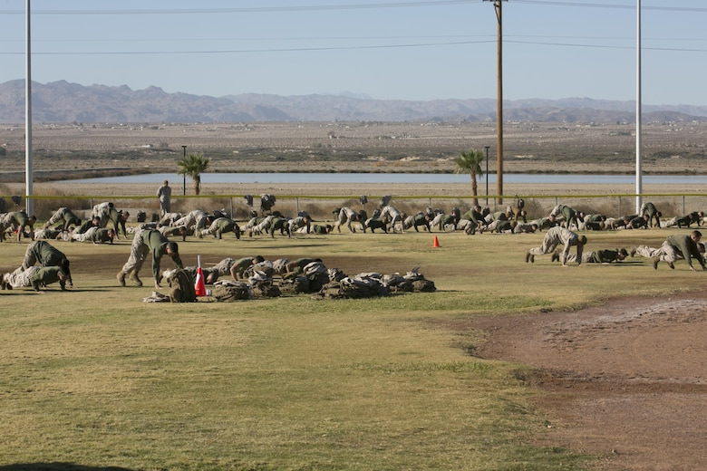 Marines of 1st Tank Battalion conduct physical training during the battalion's operational pause at Del Valle Field aboard the Marine Corps Air Ground Combat Center, Twentynine Palms, Calif., Nov. 29, 2016. (Official Marine Corps photo by Cpl. Thomas Mudd/Released)