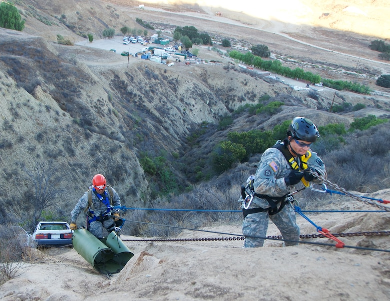 A Hawaii Air Natioanl Guard Airmen and Hawaii Army National Guard Soldier repel down a cliff to a car wreck prop during a cliff rescue scenario at Exercise Vigilant Guard 2017, Delle Valle Regional Center, California, Nov. 17, 2016. The service members are part of a Hawaii Natonal Guard team that focuses on emergency response. Vigilant Guard is an exercise program sponsored by United States Northern Command in conjunction with National Guard Bureau to provide State National Guards an opportunity to improve cooperation and relationships with their regional civilian, military, and federal partners in preparation for emergencies and catastrophic events. (U.S. Air National Guard photo by Senior Airman Orlando Corpuz)