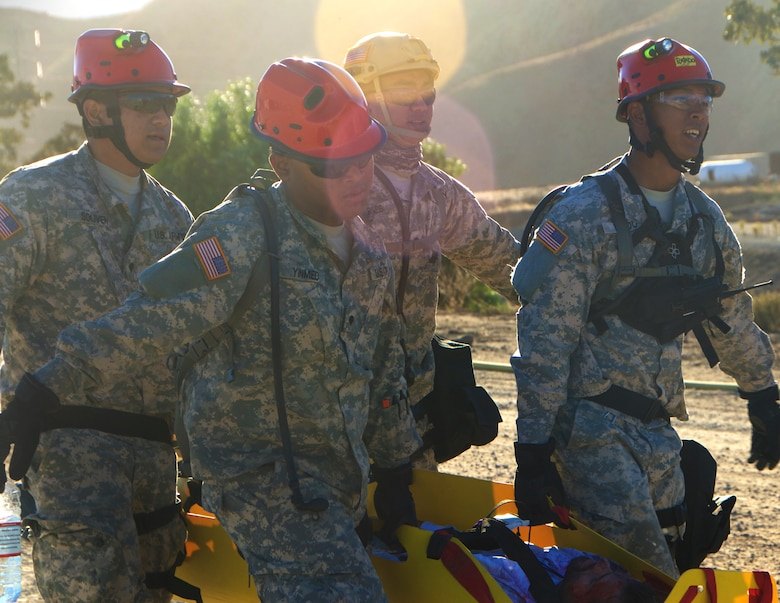 Hawaii Army National Guard soldiers evacuate a simulated victim during a medical evacuation scenario at Exercise Vigilant Guard 2017, Delle Valle Regional Center, California, Nov. 17, 2016. Vigilant Guard is an exercise program sponsored by United States Northern Command in conjunction with National Guard Bureau to provide State National Guards an opportunity to improve cooperation and relationships with their regional civilian, military, and federal partners in preparation for emergencies and catastrophic events. (U.S. Air National Guard photo by Senior Airman Orlando Corpuz)