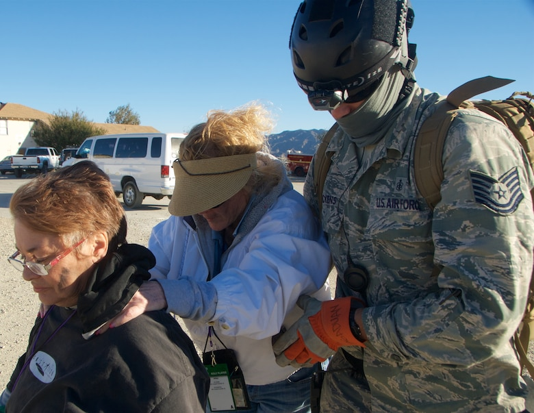 Tech. Sgt. John Nickens with the Hawaii Air National Guard's Detachment 1 Headquarters 154th Medical Group assists two simulated victims during a medical evacuation scenario at Exercise Vigilant Guard 2017, Delle Valle Regional Center, California, Nov. 17, 2016. Vigilant Guard is an exercise program sponsored by United States Northern Command in conjunction with National Guard Bureau to provide State National Guards an opportunity to improve cooperation and relationships with their regional civilian, military, and federal partners in preparation for emergencies and catastrophic events. (U.S. Air National Guard photo by Senior Airman Orlando Corpuz)