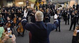 U.S. Air Force Band Commander Col. Larry H. Lang conducts the band's annual holiday flash mob performance at the Smithsonian National Air and Space Museum in Washington, D.C., Nov. 29, 2016. (U.S. Air Force photo by Jim Varhegyi)