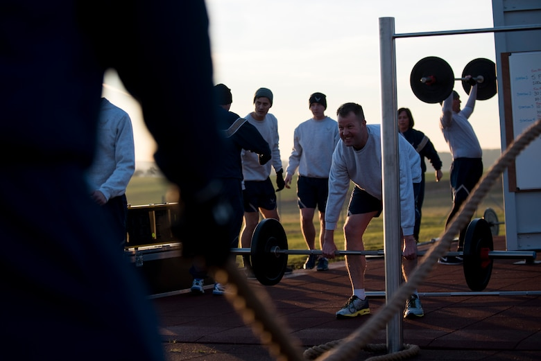 U.S. Air Force Command Chief Master Sgt. Edwin Ludwigsen, 52nd Fighter Wing command chief, performs a deadlift exercise using the new Fitness-In-A-Box outside the Powerhaus Fitness Center on Spangdahlem Air Base, Germany, Nov. 30, 2016. The physical training session included wing leadership working out with Fitness-In-A-Box, a lockable unit complete with strength and conditioning training equipment. (U.S. Air Force photo by Airman 1st Class Preston Cherry)