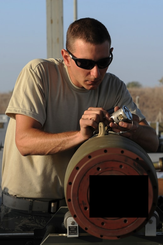 U.S. Air Force Staff Sgt. Benjamin, a 447th Expeditionary Aircraft Maintenance Squadron munitions systems journeyman, plugs in a component on a GBU-54 Laser Joint Direct Attack Munition bomb Oct. 29, 2016, at Incirlik Air Base, Turkey. The bombs built and delivered by the Airmen are used in Operation INHERENT RESOLVE. (U.S. Air Force photo by Airman 1st Class Devin M. Rumbaugh) (Portions of this image are blocked for security concerns)
