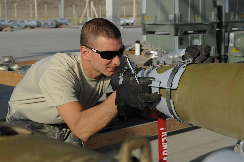 U.S. Air Force Staff Sgt. Benjamin, a 447th Expeditionary Aircraft Maintenance Squadron munitions systems journeyman, aligns a nose cone on a GBU-54 Laser Joint Direct Attack Munition bomb Oct. 29, 2016, at Incirlik Air Base, Turkey. The bombs are primarily loaded onto A-10 Thunderbolt IIs that operate out of Incirlik. (U.S. Air Force photo by Airman 1st Class Devin M. Rumbaugh)