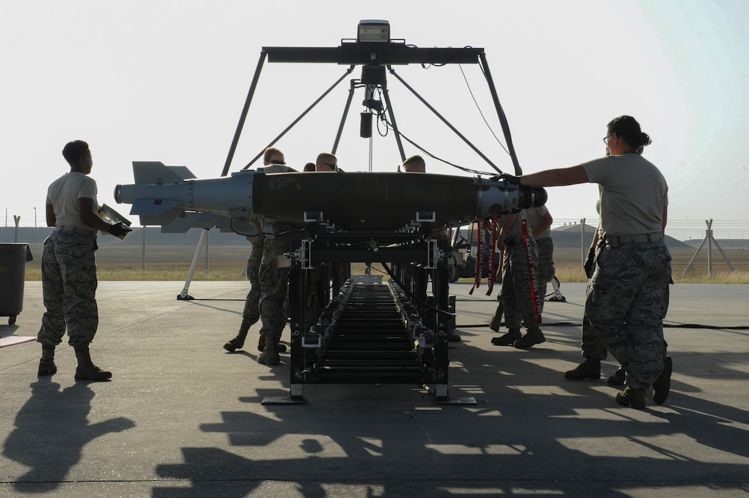 Airmen assigned to the 447th Expeditionary Aircraft Maintenance Squadron inspect completed GBU-54 Laser Joint Direct Attack Munition bombs Oct. 29, 2016, at Incirlik Air Base, Turkey. The bombs are inspected for operability before being loaded onto aircraft or placed in a storage area. (U.S. Air Force photo by Airman 1st Class Devin M. Rumbaugh)