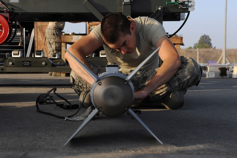 A U.S. Air Force Airman, assigned to the 447th Expeditionary Aircraft Maintenance Squadron, prepares the tail section of a GBU-54 Laser Joint Direct Attack Munition bomb Oct. 29, 2016, at Incirlik Air Base, Turkey. The bombs are tested before either being loaded onto aircraft or placed in a storage area. (U.S. Air Force photo by Airman 1st Class Devin M. Rumbaugh)