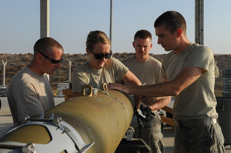 U.S. Air Force Airmen assigned to the 447th Expeditionary Aircraft Maintenance Squadron, attach the tail section of a GBU-54 Laser Joint Direct Attack Munition bomb Oct. 29, 2016, at Incirlik Air Base, Turkey. The Airmen are all Munitions Systems specialists, responsible for assembling and processing of munitions. (U.S. Air Force photo by Airman 1st Class Devin M. Rumbaugh)