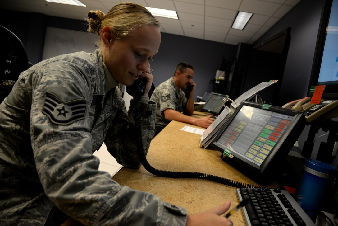 Staff Sgt. Paris Jepko, Command Post 42nd Air Base Wing noncommissioned officer in charge of reports, and Tech. Sgt. Donald Bridgers, Command Post 908th Airlift Wing NCOIC of reports, answer phone calls Sept. 14, 2016, Maxwell Air Force Base, Ala. The Maxwell command post serves as the eyes and ears for the base. Their duties include keeping track of the 908th AW aircraft and administer any emergency response as well as command and operate on-base facilities. (U.S. Air Force photo/ Senior Airman Alexa Culbert)
