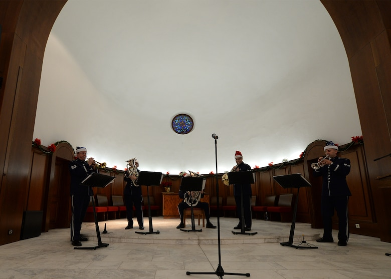 Members from Five Star Brass, a component of the United States Air Forces in Europe Band, play Christmas music at Vogelweh Military Complex, Germany, Nov. 29, 2016. Five Star Brass, played traditional Christmas music during the introduction of the ceremony as part of the program (U.S. Air Force photo by Senior Airman Jimmie D. Pike)