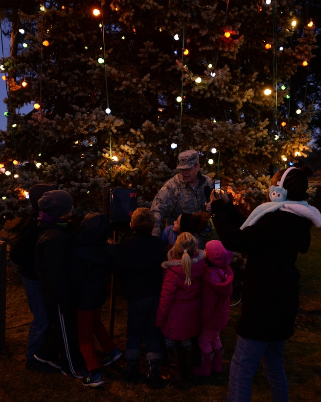 Brig. Gen. Richard G. Moore Jr., 86th Airlift Wing commander, and children from the Vogelweh community turn on the Christmas tree lights on Vogelweh Military Complex, Germany, Nov. 29, 2016. The tree lighting ceremony marked the beginning of the holiday season at Vogelweh. (U.S. Air Force photo by Senior Airman Jimmie D. Pike)