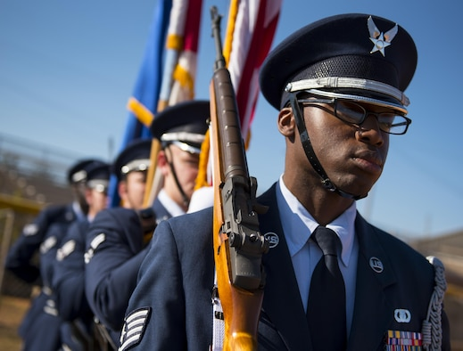 Staff Sgt. Jeremy Wortham waits to lead in an honor guard flag detail to a ceremony Nov. 16, 2016, at Eglin Air Force Base, Fla. In 2016, the base's honor guard teams traveled 190,823 miles to complete 458 details between 20 counties and two states. (U.S. Air Force photo/Samuel King Jr.)