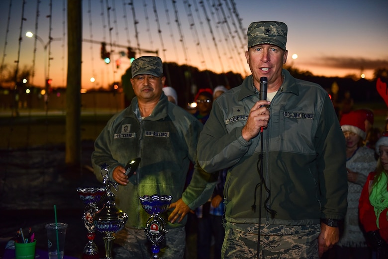 Brig. Gen. Patrick Doherty, 82nd Training Wing commander, and Chief Master Sgt. Joseph Pritchard, 82nd TRW command chief, provide opening comments and introduce the Sheppard Elementary School choir before lighting the holiday tree at Sheppard Air Force Base, Texas, Dec. 1, 2016. Each year in December, Sheppard lights a commemorative tree in the spirit of diversity and celebrating the holidays. (U.S. Air Force photo by Senior Airman Kyle E. Gese)