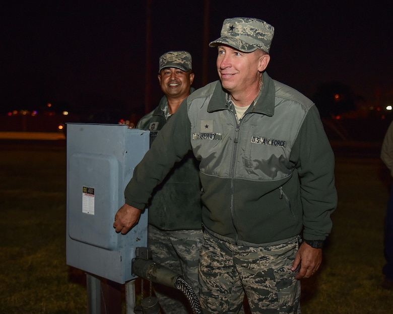 Brig. Gen. Patrick Doherty, 82nd Training Wing commander, and Chief Master Sgt. Joseph Pritchard, 82nd TRW command chief, light the holiday tree at Sheppard Air Force Base, Texas, Dec. 1, 2016. Each year in December, Sheppard lights a commemorative tree in the spirit of diversity and celebrating the holidays. (U.S. Air Force photo by Senior Airman Kyle E. Gese)