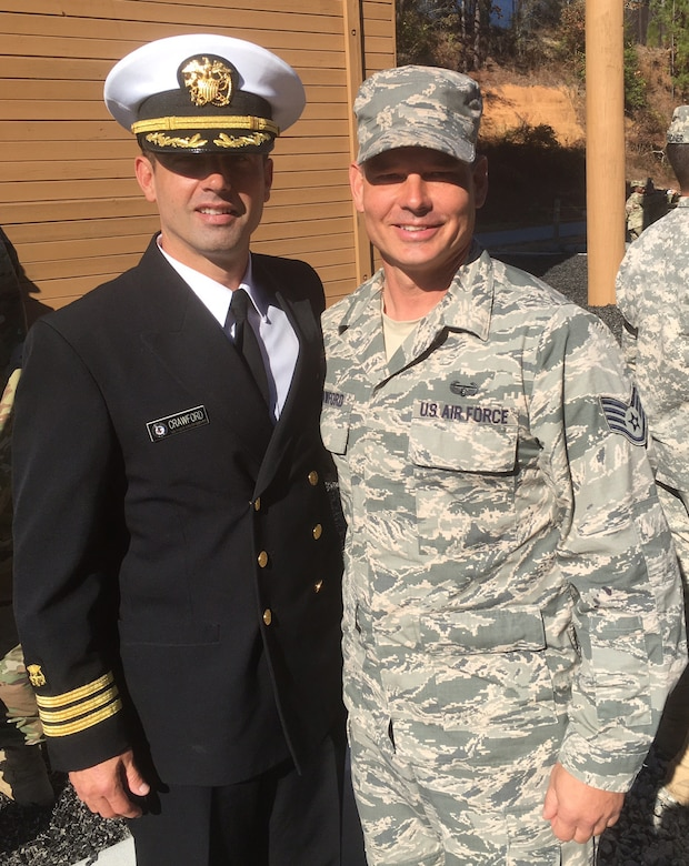 Staff Sgt. Kurtis Crawford, 512th Airlift Control Flight, Dover Air Force Base, Del., stands with his brother Navy Commander Todd Crawford, Department of Defense Health Services, Nov. 18, 2016, following Crawford's graduation from the Army's Air Assault School at Ft. Benning, Ga. Crawford's brother pinned on his air assault wings as part of the graduation ceremony. (U.S. Air Force/Courtesy Photo)