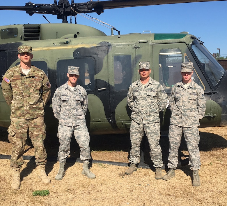 Staff Sgt. Kurtis Crawford (center right) and Senior Airman Tyler McPhail (right), both assigned to the 512th Airlift Control Flight, Dover Air Force Base, Del., graduated Nov. 18, 2016, from the Army's Air Assault School at Ft. Benning, Ga. Crawford, a C-17 loadmaster, and McPhail, a command and control specialist, are the first reserve airlift control flight members to complete the 12-day course designed to prepare Soldiers for air mobile operations. Also pictured are two active-duty Airmen who graduated in the same class; they are Staff Sgt. Phillip Zakarain, Moody Air Force Base, Ga., and Senior Airman Carlos Mendez, MacDill AFB, Fla.