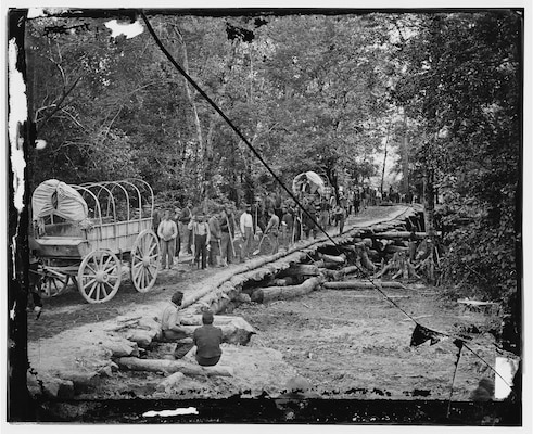 The route of march led across numerous bayous that Union engineers had to bridge with materials at hand, similar to these Union troops from Wisconsin. Gin houses and barns were dismantled to provide the necessary material in the approach to Vicksburg.