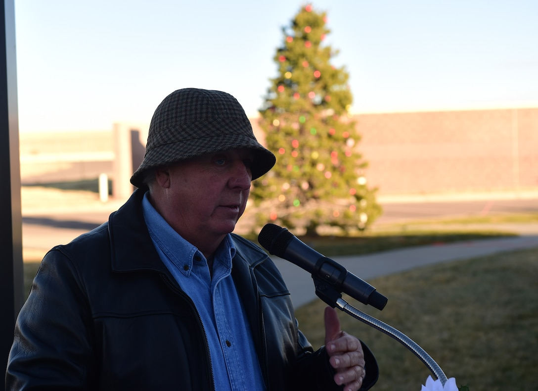 Craig Mansfield, father of Senior Airman Kristopher Mansfield, provides closing remarks during a tree lighting ceremony Dec. 1, 2016, honoring his son and Senior Airman Michael Synder at the 460th Space Communications Squadron on Buckley Air Force Base, Colo. The ceremony stands as a reminder of the two Airmen who were tragically taken too soon by drunk drivers. (U.S. Air Force photo by Airman 1st Class Gabrielle Spradling/Released)