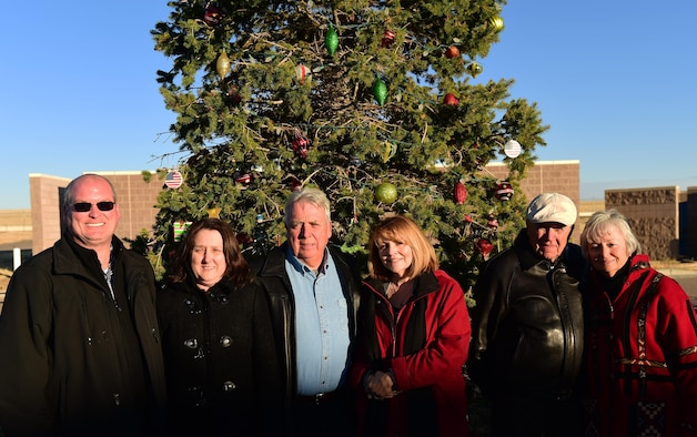 The Mansfield and Snyder families stand together Dec. 1, 2016, in front of the Christmas tree honoring Senior Airman Kristopher Mansfield and Senior Airman Michael Synder at the 460th Space Communications Squadron on Buckley Air Force Base, Colo. The ceremony stands as a reminder of the two Airmen who were tragically taken too soon by drunk drivers. (U.S. Air Force photo by Airman 1st Class Gabrielle Spradling/Released)