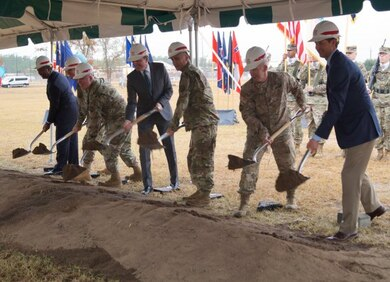 (Left to right) Augusta, Georgia Mayor Hardie Davis Jr.; Maj. Gen. John B. Morrison Jr., commanding general of the U.S. Army Cyber Center of Excellence and Fort Gordon; U.S. Army Cyber Command and Second Army Command Sgt. Maj. William G. Bruns; Secretary of the Army Eric K. Fanning; Lt. Gen. Paul M. Nakasone, commander of U.S. Army Cyber Command and Second Army; Lt. Gen. Todd T. Semonite, Chief of Engineers and commander of the U.S. Army Corps of Engineers; and John Garlington, president of B.L. Harbert International, turn the first shovelfuls of earth in a ceremonial groundbreaking marking the start of construction on the Army Cyber Command Complex at Fort Gordon, Ga., Nov. 29, 2016.