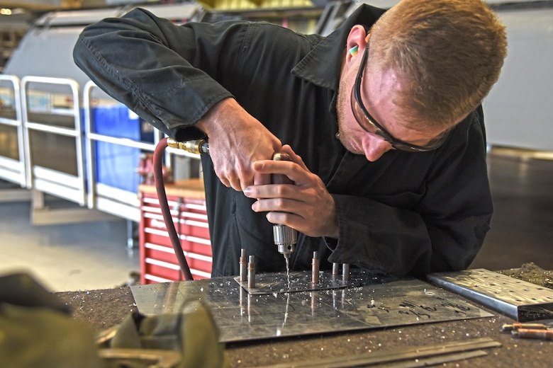 Senior Airman Logan Lingren, 92nd Maintenance Squadron aircraft structural maintenance technician, creates a rivet pattern on a piece of sheet metal Nov. 15, 2016, at Fairchild Air Force Base. Lingren has been at Fairchild since 2012. He leads many programs in his shop and trains new Airmen on the basics of aircraft structural maintenance. (U.S. Air Force photo/Senior Airman Mackenzie Richardson)