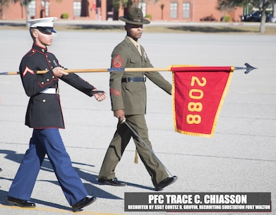 Private First Class Trace C. Chiasson marches across the parade deck during the pass and review  portion of recruit graduation Dec. 2, 2016, aboard Marine Corps Recruit Depot, Parris Island, South Carolina. Chiasson is the honor graduate of platoon 2088 and was recruited by Staff Sgt. Corez R. Griffin from Fort Walton, Florida. (Official Marine Corps photo by Cpl. Diamond N. Peden/Released)