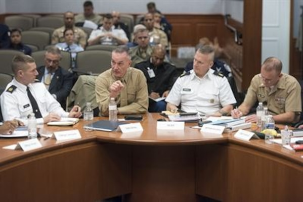 Marine Corps Gen. Joe Dunford, chairman of the Joint Chiefs of Staff, second from left, makes a point during a wide-ranging discussion with the Defense Senior Enlisted Leadership Council at the Pentagon, Dec. 1, 2016. To the left of the general is Sergeant Major of the Army Dan Dailey, to the right is Army Command Sgt. Maj. John W. Troxell, the senior enlisted advisor to the chairman, and Master Chief Petty Officer of the Navy Steven S. Giordano. The council consists of service and combatant command senior enlisted advisors. DoD photo by Navy Petty Officer 2nd Class Dominique A. Pineiro