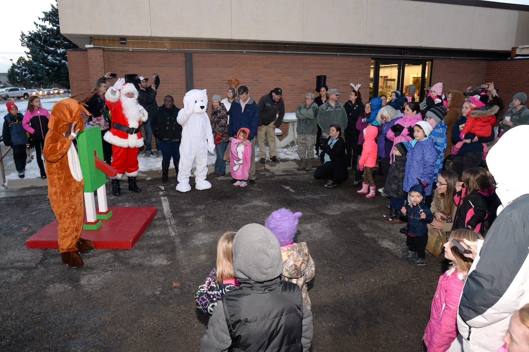 Hill Air Force Base families anticipate the Christmas tree lighting Nov. 30 at the Arts & Crafts Center on base. (U.S. Air Force photo by Todd Cromar)