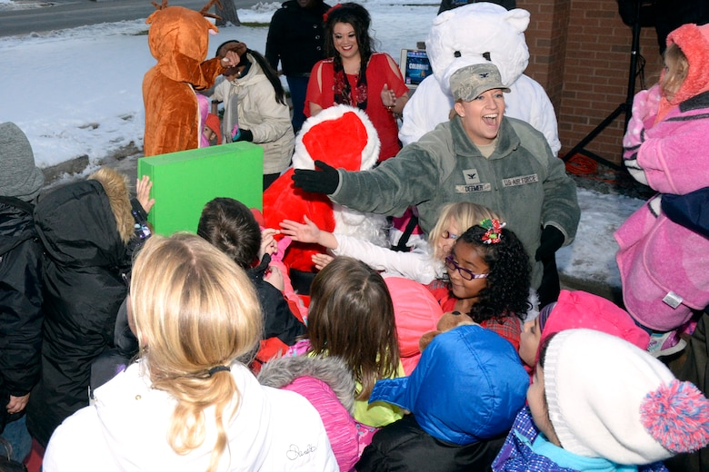 Col. Wendy Deemer, 75th Air Base Wing, joins children to flip a witch, which lights the Hill Air Force Base Christmas tree, Nov. 30. (U.S. Air Force photo by Todd Cromar)