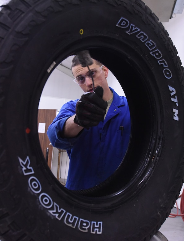 Airman 1st Class Johnathan Allen, 341st Logistics Readiness Squadron vehicle maintenance apprentice, uses tire lube on a light truck tire to easily install the rim at the LRS tire shop Dec. 1, 2016, at Malmstrom Air Force Base, Mont. The tire lube helps with setting the sealant of the tire to prevent it from moving. (U.S. Air Force photo/Senior Airman Jaeda Tookes)