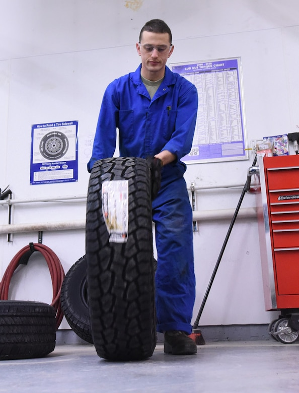 Airman 1st Class Jonathan Allen, 341st Logistics Readiness Squadron vehicle maintenance apprentice, rolls a tire to a tire machine at the LRS tire shop Dec. 1, 2016, at Malmstrom Air Force Base, Mont. The tire machine is used to make it easier to conduct work on the tire. (U.S. Air Force photo/Senior Airman Jaeda Tookes)
