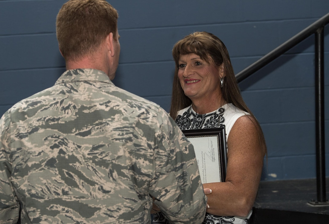 Retired U.S. Air Force Maj. Laura Perry, 45th Medical Operations Squadron master social worker, talks with an attendee after a speaking engagement, Dec. 2, 2016, at Moody Air Force Base, Ga. Perry was instrumental in the fight for transgender military members to openly serve and travels the country sharing her story. (U.S. Air Force photo by Airman 1st Class Janiqua P. Robinson)
