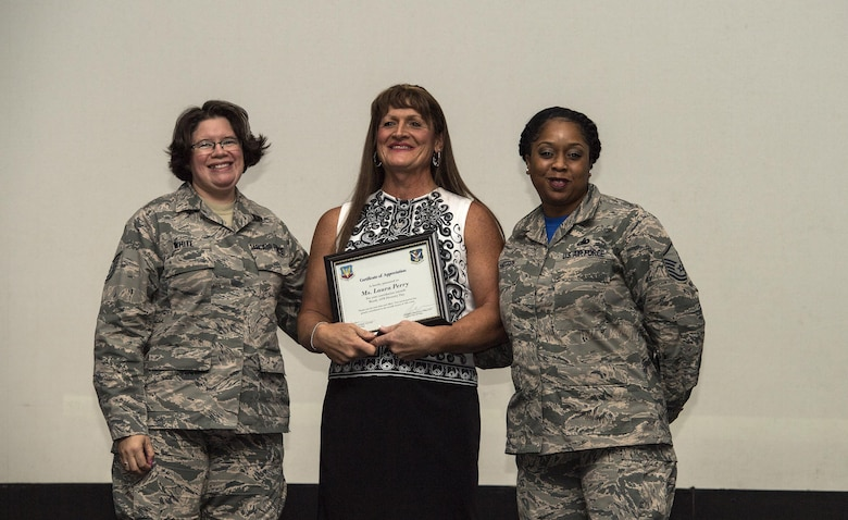 Retired U.S. Air Force Maj. Laura Perry, center, 45th Medical Operations Squadron master social worker, poses for a photo after a speaking engagement, Dec. 2, 2016, at Moody Air Force Base, Ga. Perry spoke about her journey as a transgender veteran and what the opportunity to openly serve has given military members in this community as part of Moody's Diversity Day celebrating LGBT Pride month. (U.S. Air Force photo by Airman 1st Class Janiqua P. Robinson)