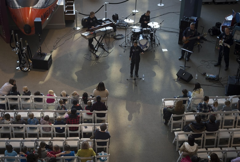 Max Impact, the U.S. Air Force's premier rock band, performs at the Smithsonian National Air and Space Museum in Washington, D.C., Dec. 2, 2016. The band performed several times throughout the afternoon, playing several holiday favorites. (U.S. Air Force photo by Senior Airman Mariah Haddenham)