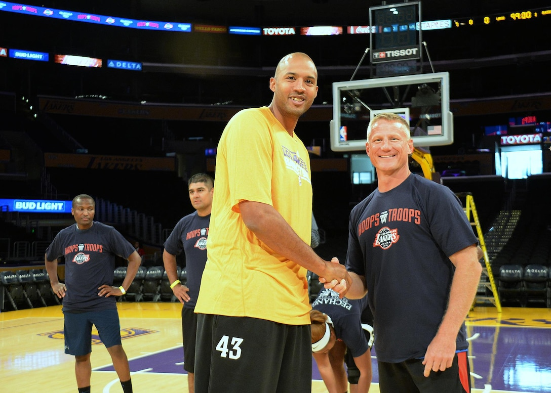 "Chief Master Sgt Craig S. Hall, Command Chief Space and Missile Systems Center, right, greets former Laker Brian Cook before they take to the hardwood. Military members of the Los Angeles Air Force Base participated in the Lakers preseason ""Hoops for Troops"" basketball clinic which was held at the Staple Center in Los Angeles on 11 Oct. 2016. (U.S. Air Force photo by Van De Ha)"
