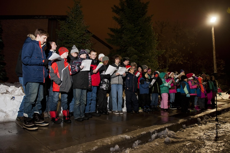 Children sing for Airmen and their families during the annual tree lighting ceremony at Minot Air Force Base, N.D., Dec. 1, 2016. The event offered an opportunity for Team Minot families to usher in the holiday season together. (U.S. Air Force photo/Airman 1st Class J.T. Armstrong)
