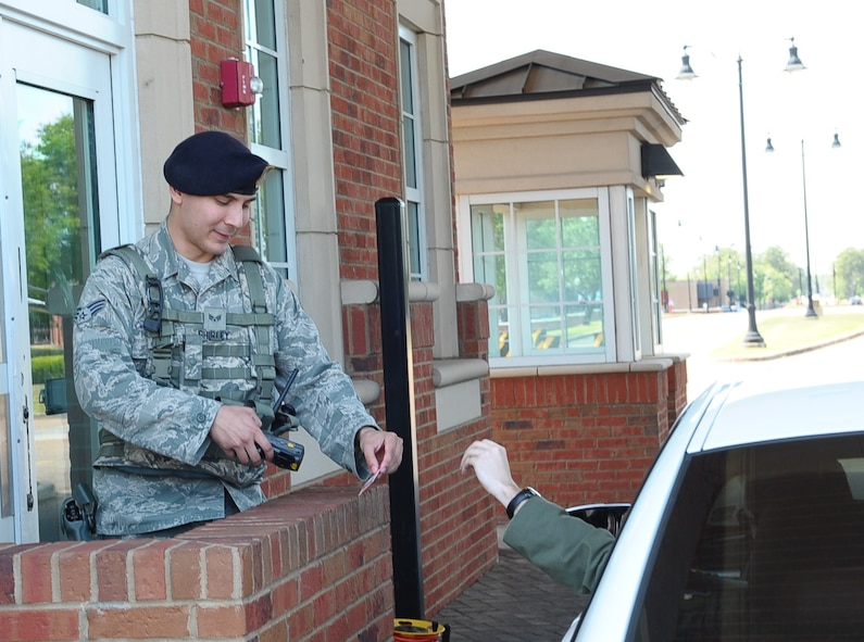 Senior Airman Patrick Shirley, 14th Security Forces Squadron Patrolman, checks the identification of a Team BLAZE member attempting to go through the main gate May 5 at Columbus Air Force Base, Mississippi. Although the main gate is open 24/7 unless otherwise stated, the back gate is only open from 6 a.m. – 6 p.m. Monday – Friday, and is closed on weekends and federal holidays. (U.S. Air Force photo by Senior Airman Kaleb Snay)